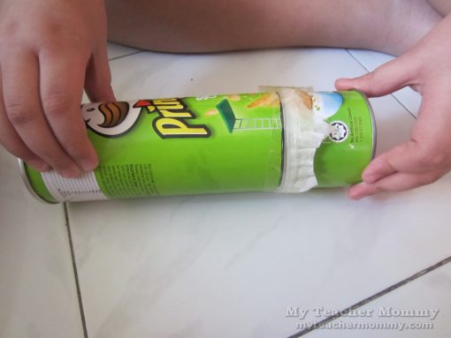 Attach the longer tube and secure all pieces with tape. (Pringles pinhole camera)