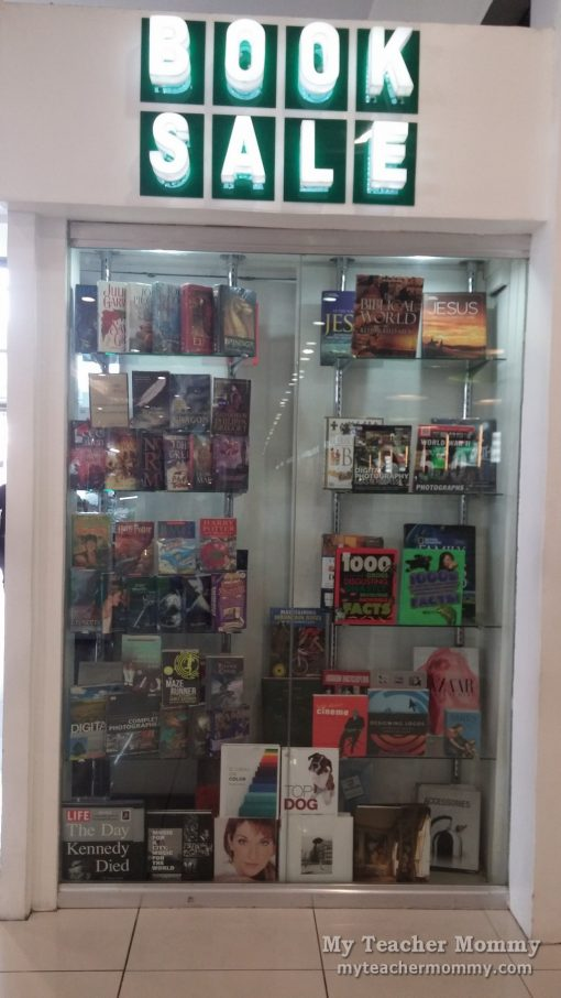 Featured books on glass display at Booksale