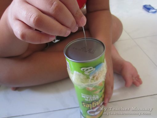 Poke a tiny hole in the center of the metal bottom of the tube. (Pringles can pinhole camera)